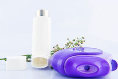 Asthma inhaler and flower of grass Royalty Free Stock Photos