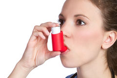 Asthma Inhaler Girl. Pretty girl holding asthma inhaler royalty free stock image