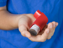 Asthma Inhaler in Hand Stock Photo