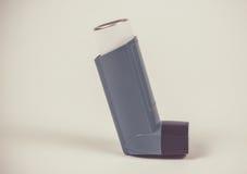 Asthma inhaler isolated on white. Stock Photos