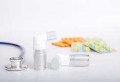 Asthma inhaler and medicine Royalty Free Stock Photos