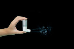 Asthma inhaler with smoke Stock Images