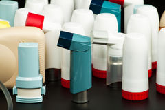 Asthma inhalers. On a dark background (medical background Stock Photography