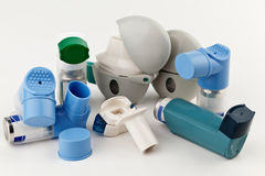 Asthma Inhalers. Close-up of asthma inhalers on white background Royalty Free Stock Images