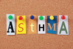 Asthma Notes. The word Asthma in cut out magazine letters pinned to a corkboard royalty free stock image