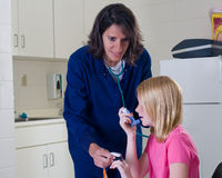 Asthma patient getting treatment from nurse. Stock Images