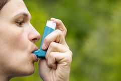 Asthma patient inhaling medication. For treating shortness of breath and wheezing. Chronic disease control, allergy induced asthma remedy and chronic pulmonary Royalty Free Stock Photos