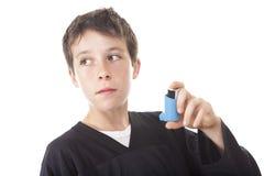 Asthma problem  Boy. A teen having an asthma problem  in studio white Stock Photo