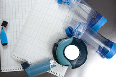 Asthma relief concept, salbutamol inhalers, medication and paper Royalty Free Stock Photo