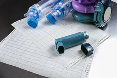 Asthma relief concept, salbutamol inhalers, medication and paper Stock Photos