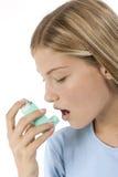Asthma Sufferer. Young woman using asthma inhaler Stock Photos