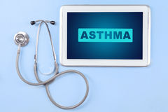 Asthma word on the digital tablet screen Royalty Free Stock Images