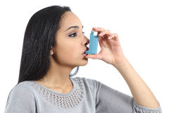 Asthmatic arab woman breathing from a inhaler. Isolated on a white background royalty free stock image