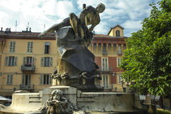 Asti (Italy). Asti (Piedmont, Italy): historic fountain with bronze statue Royalty Free Stock Images