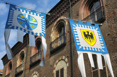 Asti (Italy). Asti (Piedmont, Italy): historic street with flags for the medieval Palio Stock Photography