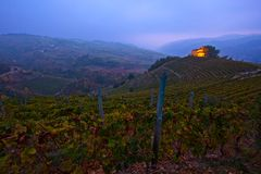 Asti vineyards. In the Asti valley after dusk and a chapel on a hill Royalty Free Stock Photos
