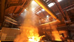 Asting ingots in foundry shop, metallurgical production. Stock footage. Melting steel at the plant, heavy industry and. Asting ingots in foundry shop royalty free stock photos