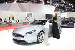 Aston Martin DB9 car with Unidentified model on display Royalty Free Stock Image