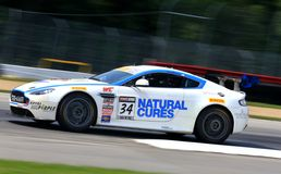 Aston Martin GT4. Nick Esayian races the Aston Martin GT4 car for Natural Cures sponsored race team at the professional motorsports racing event, International Royalty Free Stock Image