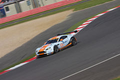 ASTON MARTIN GTE at Silverstone. Aston Martin GTE through the bends at the 6 hours of Silverstone 2014 comprting in the GTE class Royalty Free Stock Image