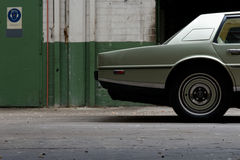 Aston Martin Lagonda – vehicle back from the side. A child of the 1970ies, the Aston Martin Lagonda broke new ground with its spacecraft like design royalty free stock photos
