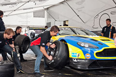 Aston Martin racing car tyre change Royalty Free Stock Images