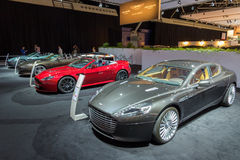 Aston Martin row of cars. AMSTERDAM - APRIL 16, 2015: A row of Aston Martin cars at the AutoRAI 2015. Aston Martin Lagonda Limited is a British manufacturer of Royalty Free Stock Photo