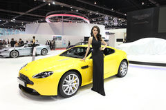 Aston Martin V8 Vantage S car with Unidentified model Royalty Free Stock Photography