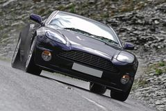 Aston Martin Vanquish S. Classic British Supercar at Speed Royalty Free Stock Images