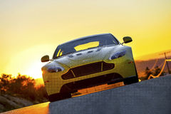 Aston Martin Vantage V12S. On a road in California at sunset Royalty Free Stock Image