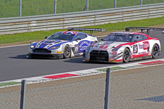 Aston martin versus nissan. On race Stock Images