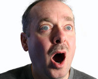 Astonished. The eyes and the open mouth of a man show the condition of being astonished by an unusual event Stock Image