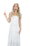 Astonished attractive model in white dress posing Royalty Free Stock Photo
