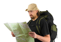 Astonished backpacker looking in the map. Over white Stock Photo
