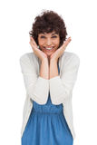Astonished brunette woman standing and smiling Stock Photos