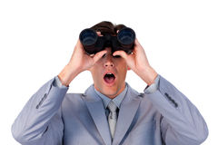 Astonished businessman looking through binoculars. Against a white background Royalty Free Stock Photo