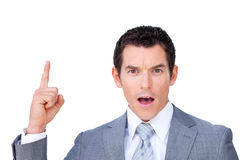 Astonished businessman pointing upward Royalty Free Stock Photography