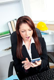 Astonished businesswoman looking at her calculator Stock Photography