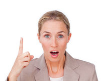Astonished businesswoman pointing upward Royalty Free Stock Image