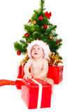 Astonished Christmas baby Stock Photography