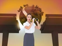 Astonished elegant businesswoman holding binoculars Royalty Free Stock Image