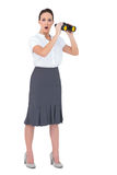 Astonished elegant businesswoman holding binoculars Stock Image
