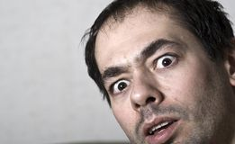 Astonished face. Face of a young caucasian astonished man Royalty Free Stock Image