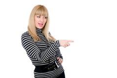 Astonished female pointing at something aside Stock Image
