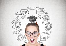 Astonished girl in round glasses, education royalty free stock photo