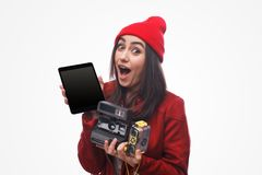 Astonished girl with various gadgets Royalty Free Stock Image