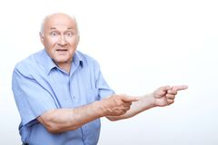 Astonished grandfather pointing to the left Royalty Free Stock Photo