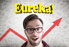 Astonished hipster guy, eureka, graph Stock Photos
