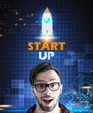 Astonished hipster guy in glasses, startup rocket Royalty Free Stock Photo