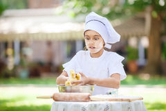 Astonished little chef holding ducklings while cooking Royalty Free Stock Photo